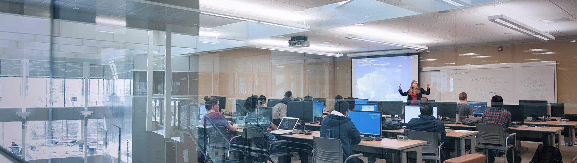 Instructor doing a presentation in computer lab